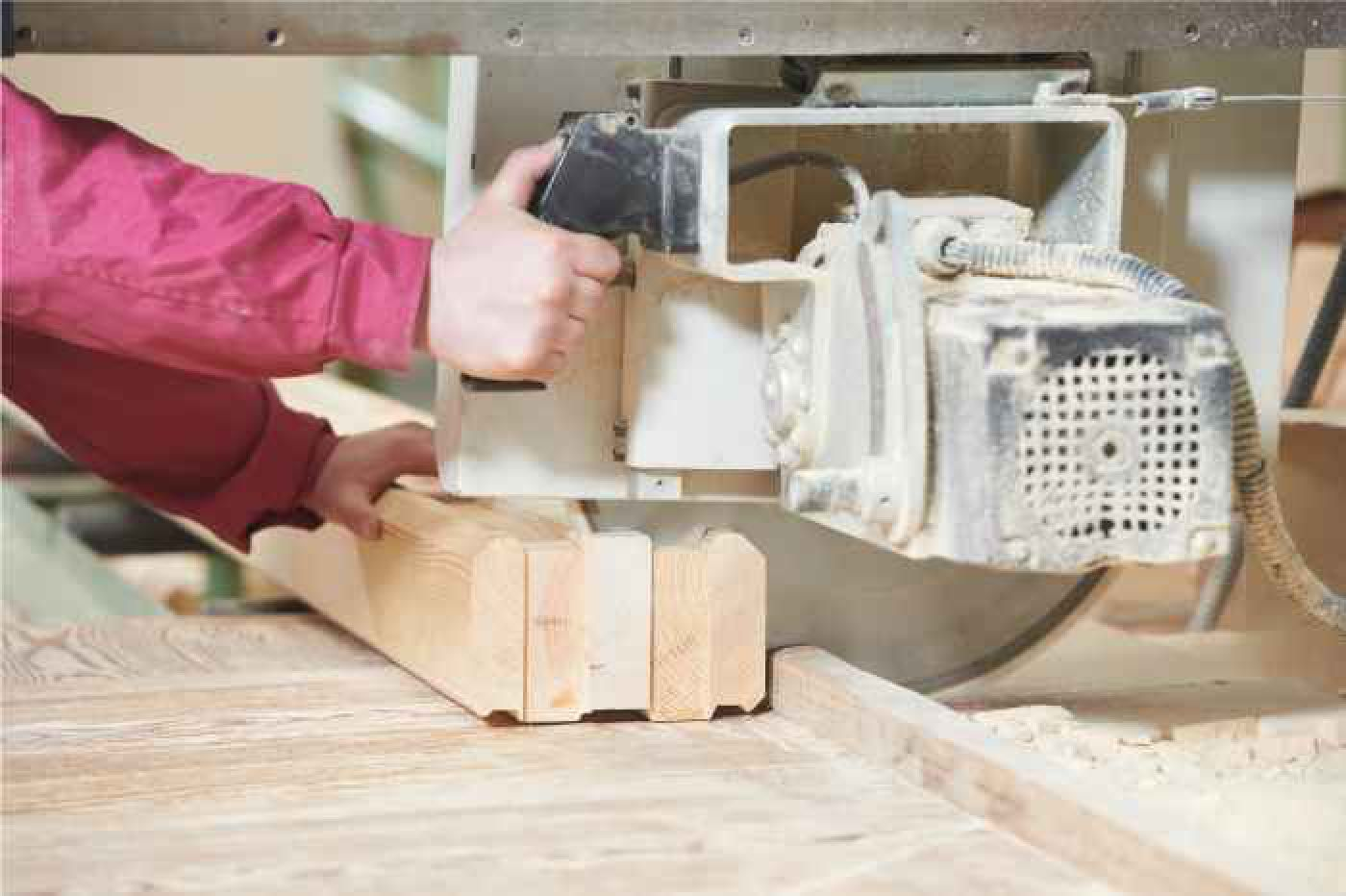 Cut-off saw being pulled through multiple 2x4 lumber